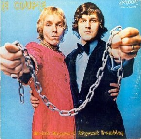 1973 LP album art for Giourard and Tremblay, shows both men with their arms chained together with manacles, raising their arms into the foreground. Art by Pierry Dury